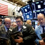 Wall St. after indexes down in choppy trade after Fed minutes